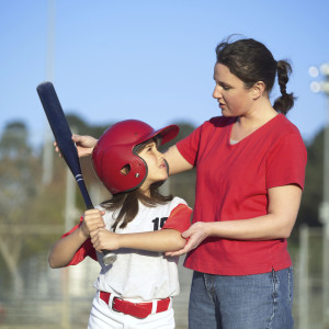 softball coach and player