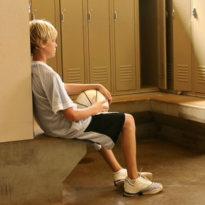 sad-basketball-kid-in-locker-room-cropped-300x300 The 4 Biggest Problems in Youth Sports Today