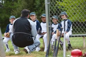 little league team playing ball