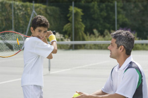 Tennis coach and boy