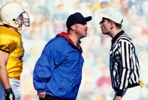 Football coach and referee arguing