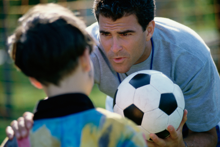 https://changingthegameproject.com/wp-content/uploads/2018/10/soccer-coach-with-boy.jpg